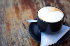 Coffee in black cup Stock Images