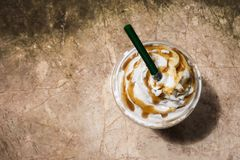 Coffee blend in plastic cup. Served with whipped cream topping. royalty free stock image