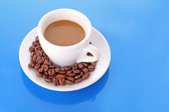 Coffee on blue backgrou Royalty Free Stock Image