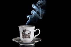 Coffee with blue smoke. Cup with a pleasant scent Following unknown Royalty Free Stock Images