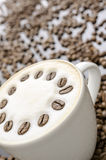 Coffee with blurred coffee beans Royalty Free Stock Photos