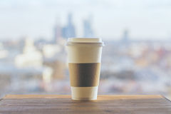 Coffee on blurry city Stock Images