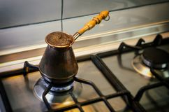 Coffee boiled in a copper cezve Stock Photos