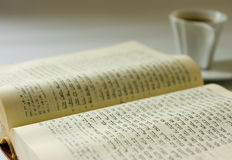 Coffee and book. Holy Bible and a cup of coffee Royalty Free Stock Photo