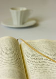 Coffee and book. Holy Bible and a cup of coffee Royalty Free Stock Image