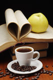 Coffee and book. Cup of coffee, apple and opened book stock photos