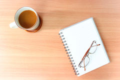 Coffee and a book with glasses Stock Image