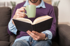 Coffee and a book are a good mix Royalty Free Stock Photos