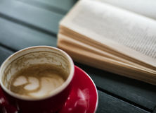 Coffee and book. Coffee latte and book are on the table stock photo