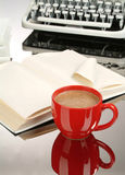 Coffee And Books. Red cup of coffee, books and old typewriter royalty free stock photo