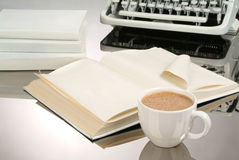 Coffee And Books. White cup of coffee, books and old typewriter stock photography