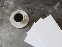 Coffee and books on marble background royalty free stock images