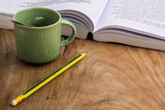 Coffee, Books , Pencil, wood, paper, spoon. Stock Photos