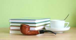 Coffee, books, pipe Stock Images