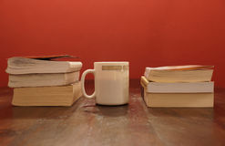 Coffee and books. Coffee and some books on a wooden table royalty free stock photography