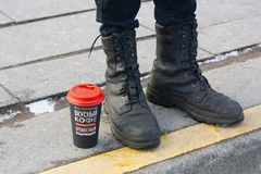 Yellow line, coffee, boots, sunny, sun, man, limit, border, red colour, royalty free stock photo