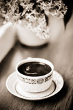 Coffee and bouquet in sepia Royalty Free Stock Photo