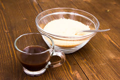 Coffee and bowl with brown sugar Royalty Free Stock Photography