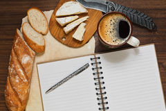 Coffee brake with french cheese. Planning the day during refined coffee break with fresh french bread and cheese stock photos