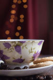 Coffee breack. Coffee beans and coffee cup with biscuits ans bokeh Stock Image