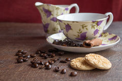 Coffee breack. Cup of coffee with cinnamon and biscuits Stock Photos