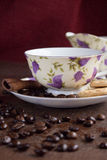 Coffee breack. Cup of coffee with cinnamon and biscuits Royalty Free Stock Images
