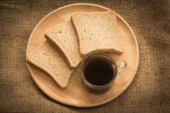 Coffee and bread for breakfast. Stock Images