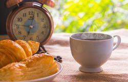 Coffee and bread Breakfast at 7.00 am stock photo