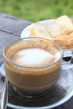 Coffee with bread in the garden royalty free stock photo