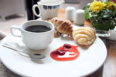 Coffee, bread and jam in white dish. Royalty Free Stock Photo