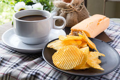 Coffee, bread and Ribbed potatoes snack Royalty Free Stock Images
