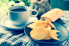 Coffee, bread and Ribbed potatoes snack Stock Image