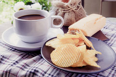 Coffee, bread and Ribbed potatoes snack Stock Photo