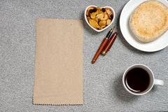 Coffee bread snack heart form dish on granite stone table and blank brown paper Stock Images