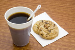 Coffee break. Instant coffee with chocolate chips cookies Royalty Free Stock Photo