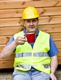Coffee break. Male construction worker taking a coffee break stock photo