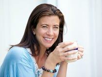 Coffee break. Beautiful woman taking a coffee break holding a mug Royalty Free Stock Image