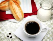 Coffee break. A cup full with hot coffee and some bread Royalty Free Stock Photos