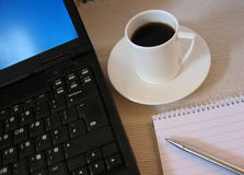 Coffee break. Laptop and coffee royalty free stock image