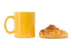 Coffee break. Yellow coffee cup with cookie Royalty Free Stock Images