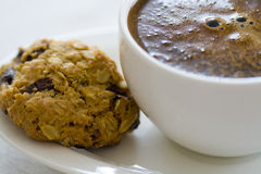 Coffee break. A cup of coffee with a healthy homemade cookie Royalty Free Stock Photo