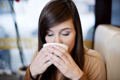 Coffee break. Close up of woman drinking coffee Royalty Free Stock Images