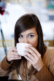 Coffee break. Close up of woman drinking coffee Stock Photos