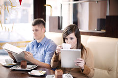 Coffee break. Young couple in cafe Stock Photos