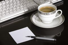Coffee Break. Cup of coffee with blank note paper stock images