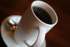 Coffee break. Hot coffee in white china. Shallow depth of field is intentional Royalty Free Stock Photo