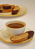 Coffee Break. Time out for walnut biscotti dipped in a cup of espresso coffee Stock Photo