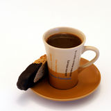 Coffee Break. Time out for walnut biscotti dipped in a cup of espresso coffee Stock Images