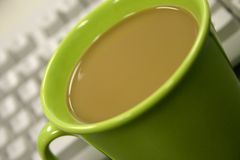 Coffee Break. Office environment showing coffee cup Stock Photo