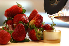 Coffee break. Come on, have some strawberries royalty free stock photography